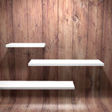White shelves with wooden wall Royalty Free Stock Images