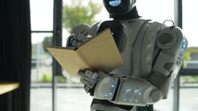 White shiny robot writing down information stock video footage