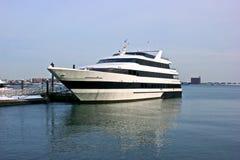 White ship. Waiting at dock in boston harbor Royalty Free Stock Photo