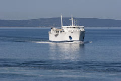 White ship on blue sea Stock Images