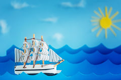 White Ship on blue wave with paper and sun. Travel and adventure concept.  Stock Image