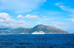 The white ship. The ferry goes to the port of Naples across the coastline of Sorrentine peninsula, next to the Capri Island, Italy stock photography
