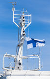 White ship mast with national flag of Finland Stock Photos