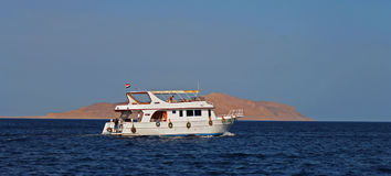 White Ship Moving By The Red Sea Stock Photo