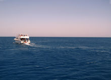 White Ship Moving By The Red Sea Royalty Free Stock Photography