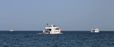 White Ship Moving By The Red Sea Royalty Free Stock Photos