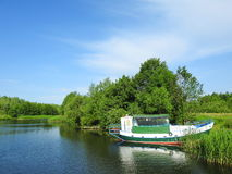 White ship and river, Lithuania Royalty Free Stock Photo