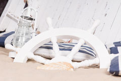 White ships wheel buried in sand Royalty Free Stock Photography