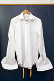 White shirt. A white shir on a navy blue background Royalty Free Stock Photography