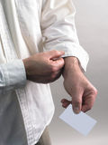 White Shirt Arm With Blank Business Card Royalty Free Stock Photo