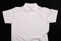 White shirt. On a black background Royalty Free Stock Photos