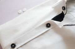White shirt with black collar and buttons Royalty Free Stock Image