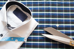 White shirt on chequered background with measuring tape. White shirt on chequered background. with measuring tape and buttons, showing tailoring. Also has Stock Images