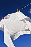 White shirt on clothes line Royalty Free Stock Photos