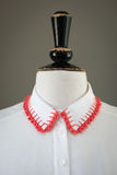White Shirt Collar with Crocheted Red Edges Stock Images