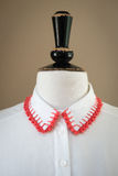 White Shirt Collar with Red Knitted Edges Royalty Free Stock Photo