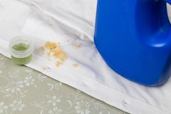 White shirt with curry gravy stain and concentrated liquid deter Royalty Free Stock Photos