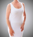 White shirt-dress on the ideal female figure. Royalty Free Stock Photos