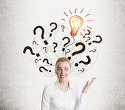 White shirt girl and light bulb with question marks Stock Photo