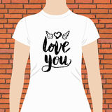 White Shirt with Love You Text and Winged Heart Royalty Free Stock Image
