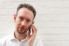 White Shirt Man on Phone Royalty Free Stock Photography