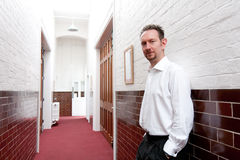 White Shirt Man in Tiled Corridor Stock Photos