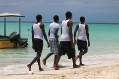 White shirt men on beach Stock Photo