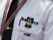 White shirt police officer closeup gay straps concept solidarity. Concept lgbt acceptance uniform police officer trainbow straps Royalty Free Stock Image