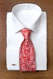 White shirt with red tie on the shelf Stock Photo