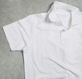 White shirt. On the table Stock Photography