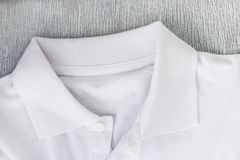 White shirt on the table. White shirt on a wooden table Royalty Free Stock Images
