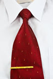 White shirt and tie. Closeup of white shirt and necktie with tie pin royalty free stock photo