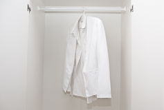 White shirt in wardrobe Royalty Free Stock Image