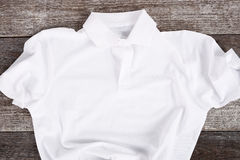 White shirt. On the wooden table Royalty Free Stock Photos