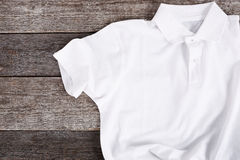 White shirt. On the wooden table Royalty Free Stock Photo