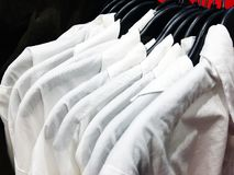 White shirts on a hanger in the store. Royalty Free Stock Images