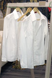 White shirts hangers Royalty Free Stock Photos