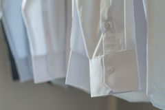 White shirts hanging on rack Royalty Free Stock Photo