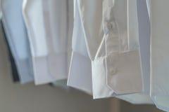 White shirts hanging on rack Royalty Free Stock Photo