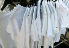 White shirts hanging for sale Royalty Free Stock Photo