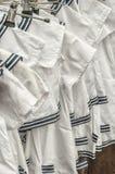 White polo shirts on a rack royalty free stock photo