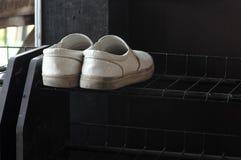 White shoe. On black shelves Royalty Free Stock Image