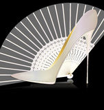 White shoe and fan Royalty Free Stock Image