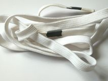 Shoelaces. White shoelaces on white background stock images