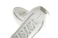 White shoes. Creative shot of a pair of white basketball shoes Stock Images