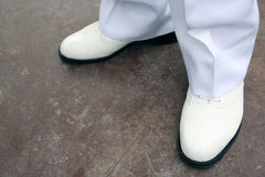 White Shoes. A pair of white shoes stock photos