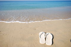 White shoes on the beach. This is white shoes on the beach.this place is in east of thailand Royalty Free Stock Photography