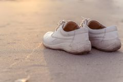 White shoes on the beach with vintage style. Royalty Free Stock Image
