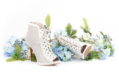 White shoes with blue flowers Royalty Free Stock Images