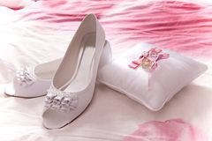 White shoes of bride with wedding rings Royalty Free Stock Photography